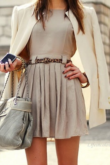 The beige a-line  pleated dress with the leopard print belt and white coat