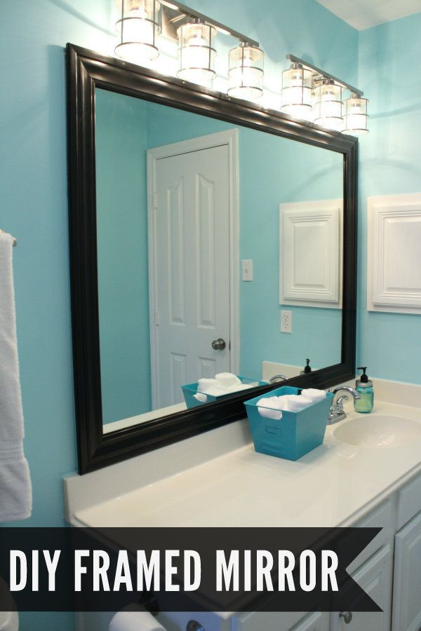 I have to paint the one in our old house black to go with my black and pink bathroom  DIY Framed Mirror Tutorial on { lilluna.com }