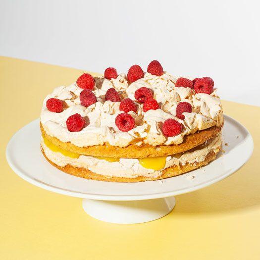 Lemon Meringue Cake filled with raspberries, lemon curd and baked ...