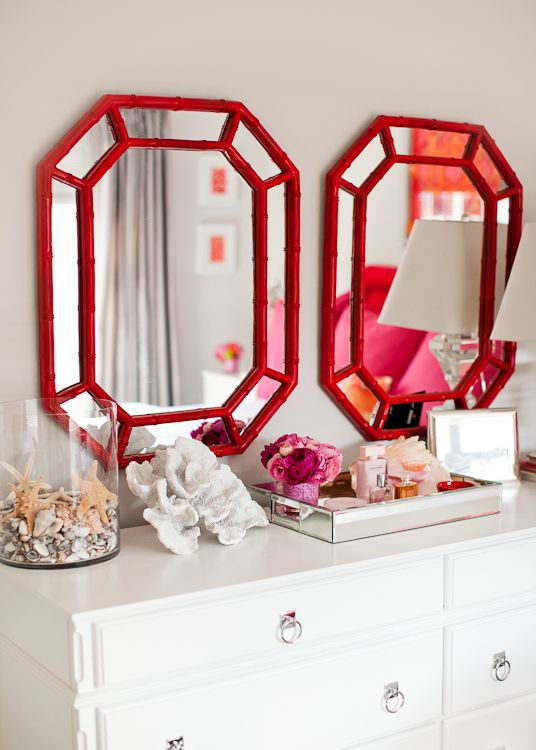 Double red bamboo mirrors over dresser. Love.