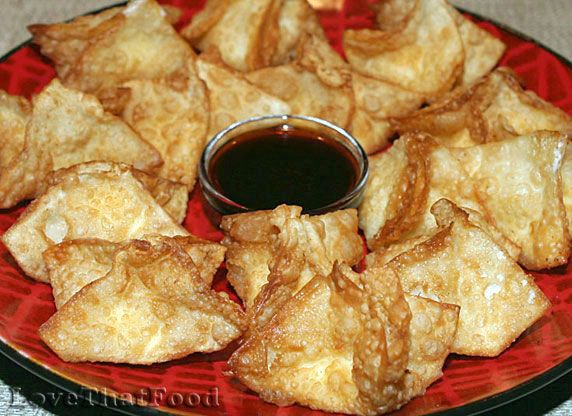 Crispy cream cheese-stuffed wonton appetizers with a hint of minced ...