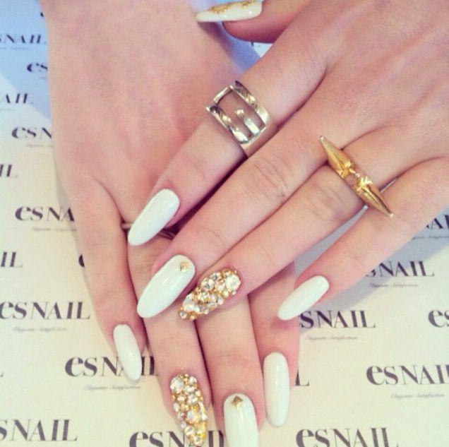 White manicure, jewels...