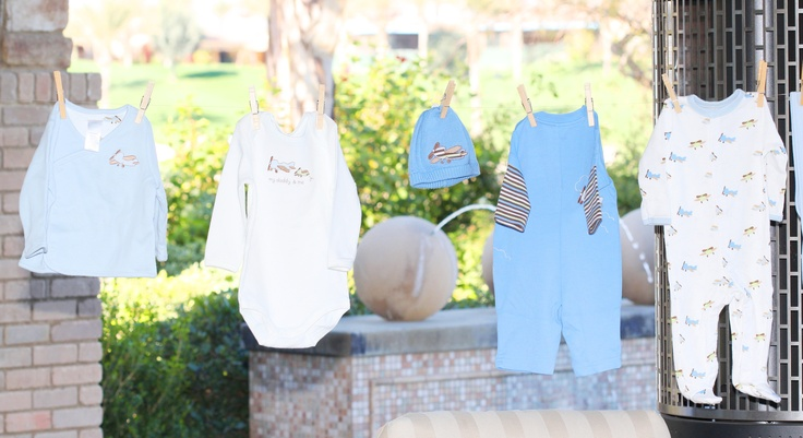 Baby shower clothesline jungle themed baby shower for Baby shower clothesline decoration