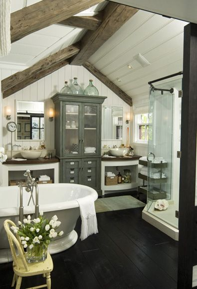 Coastal/Cottage bathroom, wood floors, cabinet between vanities, wood beams, paneled ceiling...
