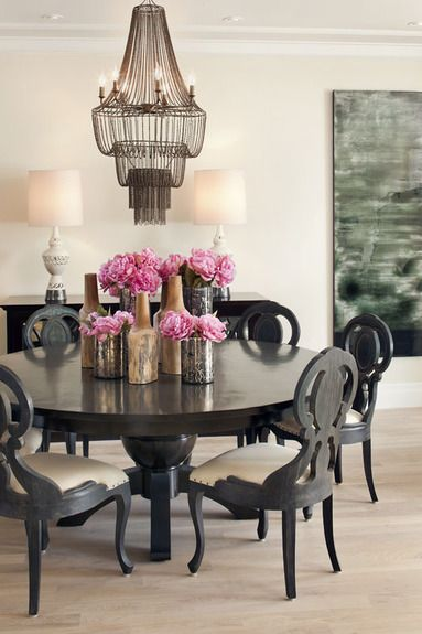 Great dramatic chic dining room with dar natural woods & a light balance
