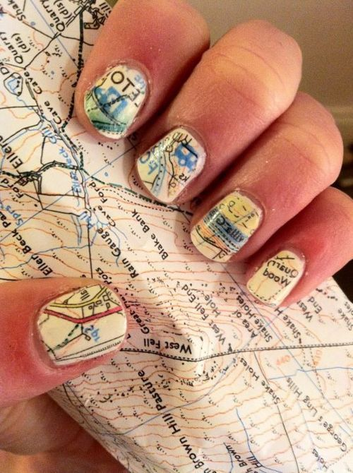 1. Paint your nails white/cream 2. Soak nails in alcohol for five minutes 3. Press nails to map and hold 4. Paint with clear nail polish immediately after. ~You can do it with scrapbook paper too!