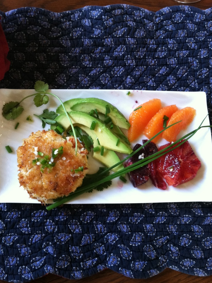 fresh crab cakes served with avocado and blood orange.