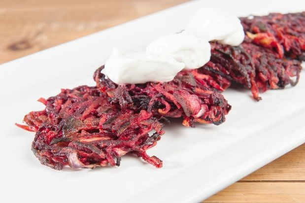 Carrot and beet pancakes, topped with sour cream, a healthier ...