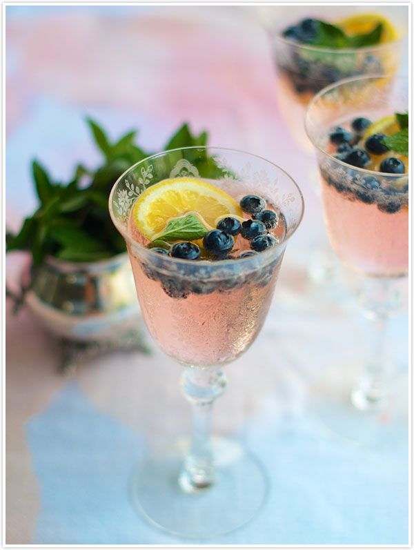 Fresh blueberries, a couple lemon slices and fresh mint, stirred up with a shot of vodka to release the flavors, and topped off with the super fizzy soda.