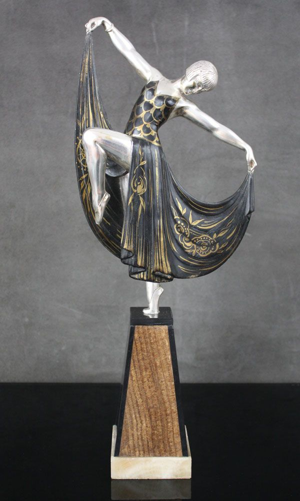 Another variation of this classic French art deco figure by Gilbert.