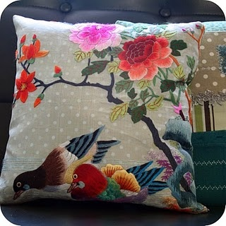 It's a panel of sheer fabric with a pair of ducks and some gorgeous flowers hand embroidered bought in a flea market and turned into a cushion.