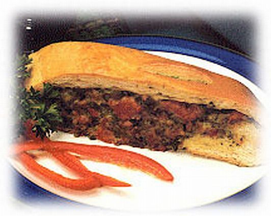 Sausage, spinach and cheese make this stomboli recipe a complete meal.