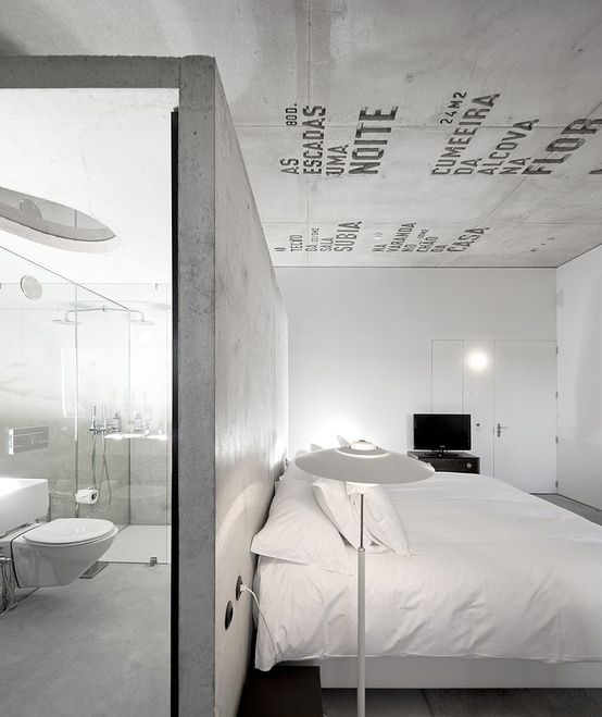concrete bedroom just like the simplicity of it and the bathroom built in the bedroom