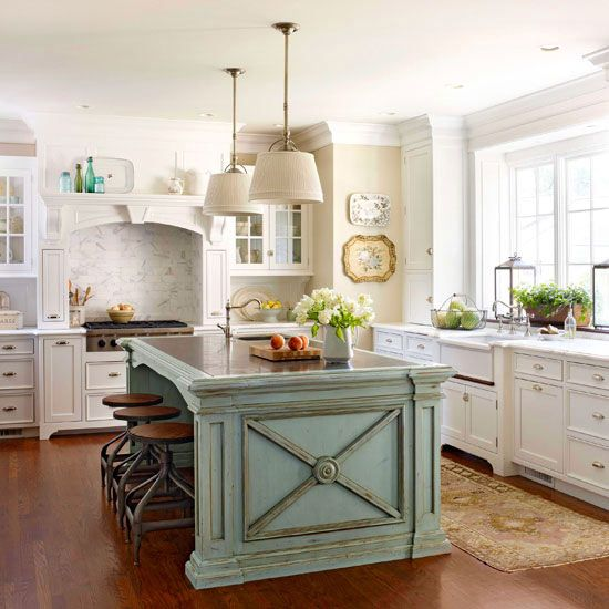 An ornate island adds a touch of traditional style to this pretty white kitchen. See more traditional kitchen ideas: http://www.bhg.com/kitchen/remodeling/planning/kitchen-remodeling-costs-traditional/?socsrc=bhgpin022713traditionalisland=8