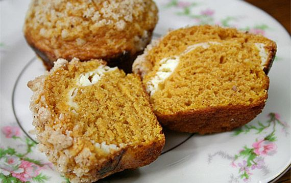 pumpkin-muffins filled with cream cheese and topped with pecan ...