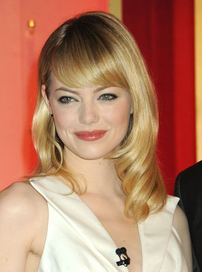 Emma Stone: Sleek and polished, Emma Stone's midlength fringe is a perfect example of bangs that can be styled down the center or swept off to the side.