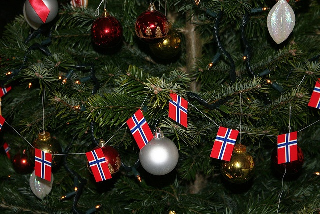 We put these traditional flags on our christmas tree every year it s