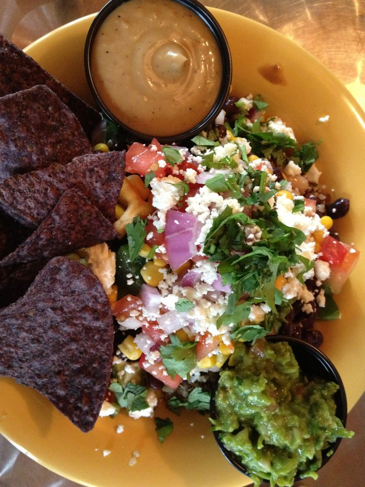 Dandelion Communitea Cafe -- Bean There Done That Bowl with quinoa and whirled peas guacamole. The gingerous dressing is so good!  http://dandelioncommunitea.com/eat/menu/