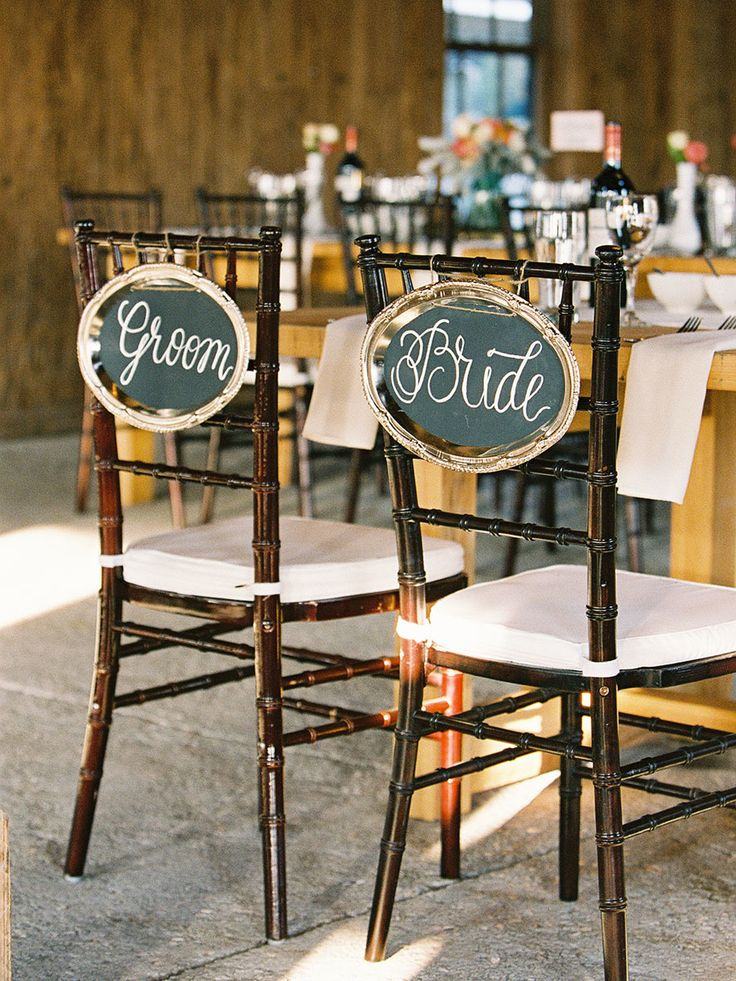 Rustic bride & groom chair signs #decor Photography: Virgil Bunao - virgilbunao.com  Read More: http://www.stylemepretty.com/2014/05/08/rustic-southern-winter-wedding/