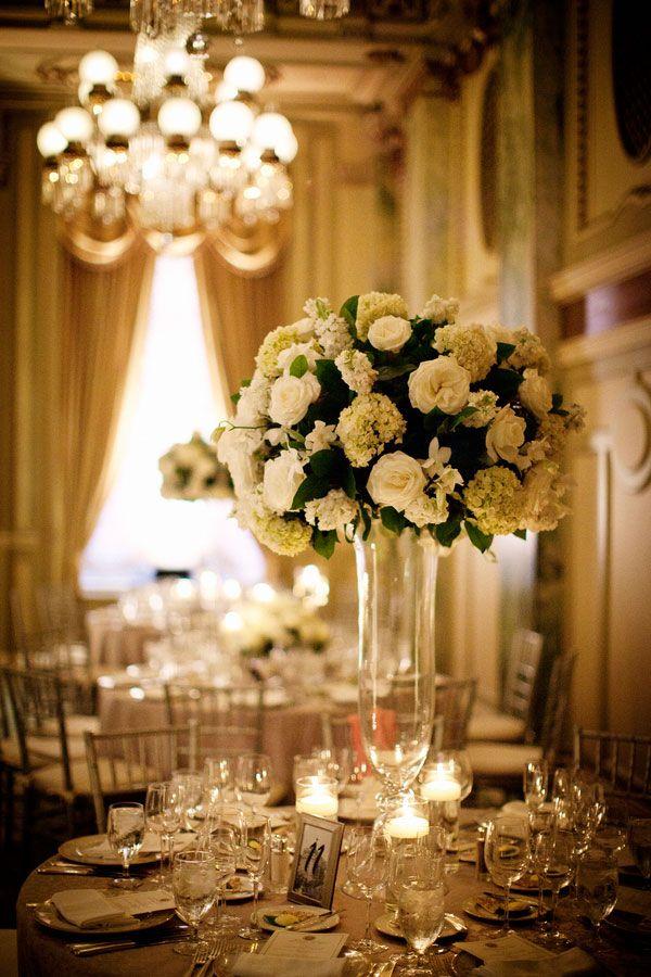 Tall floral arrangements are ideal for a #blacktie wedding. #weddingdecor #flowers