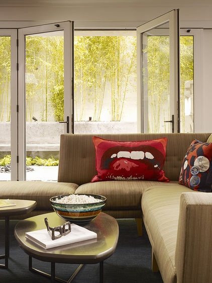 Exception: In a neutral room such as this, one look-at-me pillow focuses the design and the inhabitants' attention.