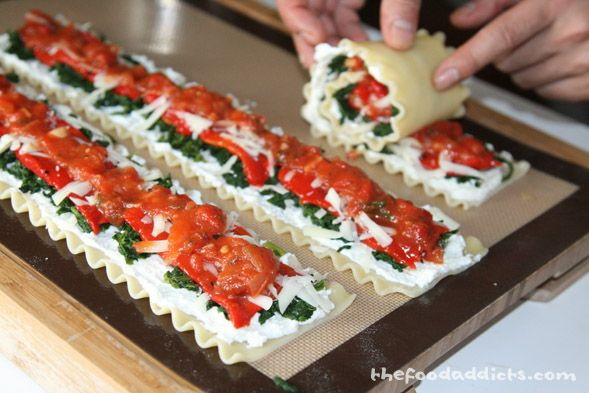 Spinach Lasagna Rolls with Roasted Red Peppers....Tempting isn't it?