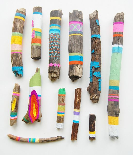 Brightly painted pieces of driftwood by Canadian artist Ginette Lapalme (Display ideas abound.)