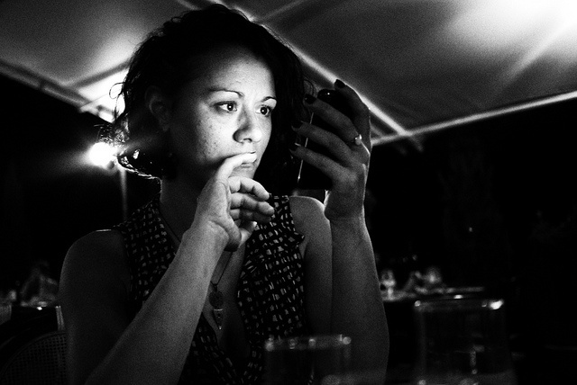 girl using phone by gorbot., via Flickr
