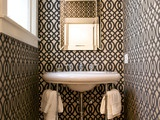 Gorgeous wall paper gives half bath personality.