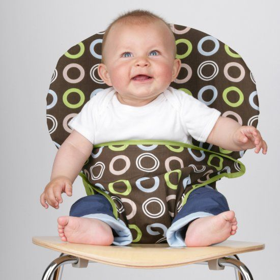 totseat!  works on almost any chair and squishes up small enough to fit in a diaper bag.