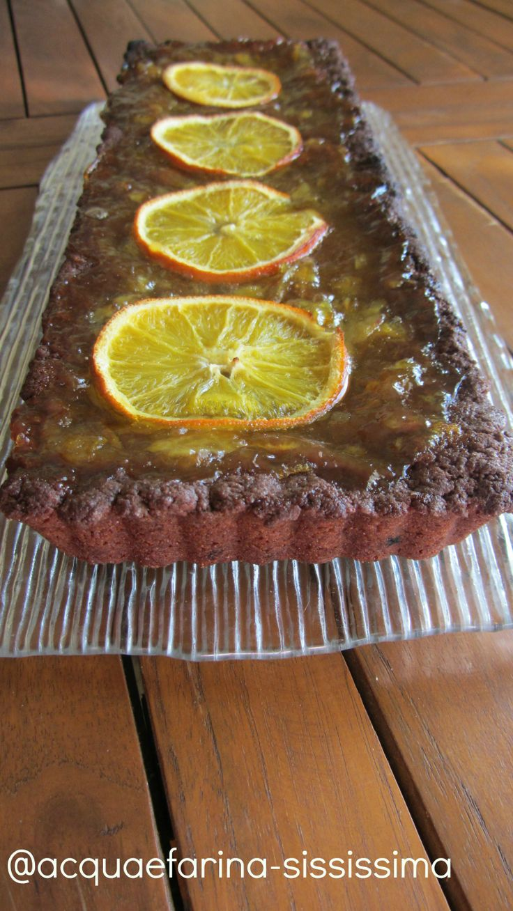 ... di arancia/tart with chocolate pastry with hazelnut oil and orange jam