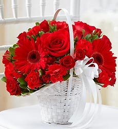 All Red Flower Girl Basket    $25.00    EXCLUSIVE Red roses, exquisite Gerbera daisies, red mini carnations and red spray roses create this fun, fresh Flower Girl arrangement. It's beautifully hand-crafted in a classic white handled basket to coordinate perfectly with your wedding ensemble. Basket arrangement of red roses, spray roses..