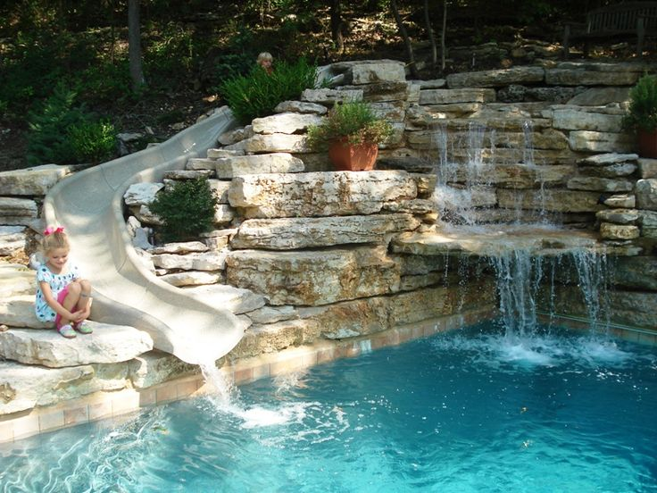 Stone pool slide love it for Garden swimming pool with slide