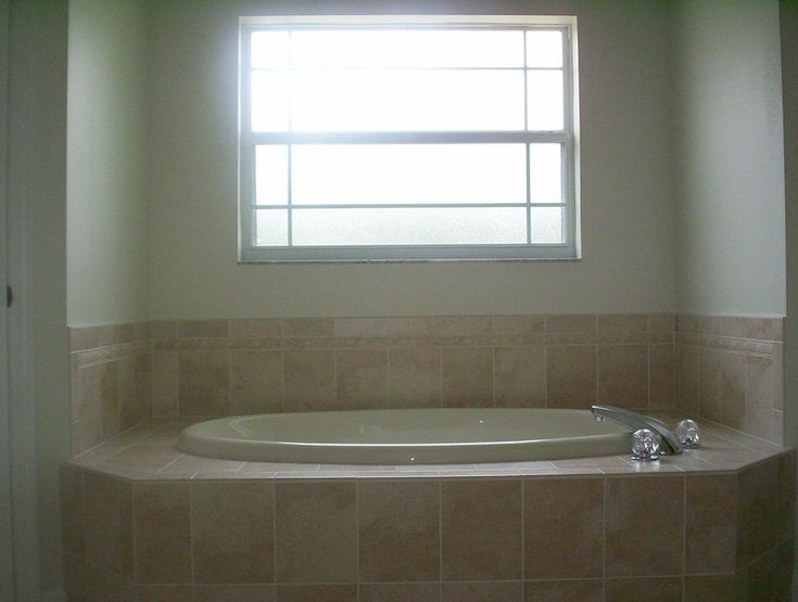 If you drop the ceiling over the tub into a dome ceiling, it will give the tub a move closed off and intimate area; make the window a little bigger and drop it down a little lower.