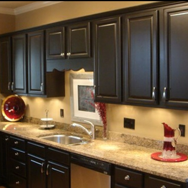 Black kitchen cabinets love these countertops