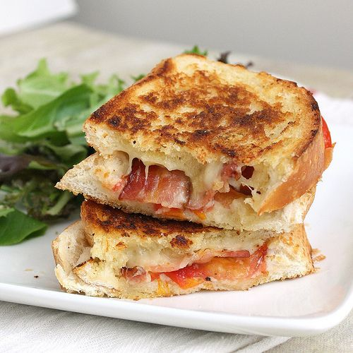 Garlic infused grilled cheese with prosciutto and tomato