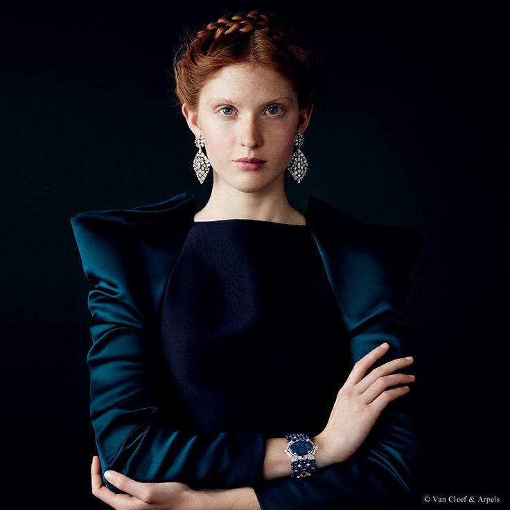 "Van Cleef & Arpels new ""Jewelry and Watches"" catalog. Majestueux earrings, Bals de Légende collection, platinum and diamonds. Canalasso bracelet, Bals de Légende collection, white gold, round and pear-shaped diamonds, baguette-cut sapphires, lapis lazuli beads and one 33.07-carat black opal (origin: Australia)."