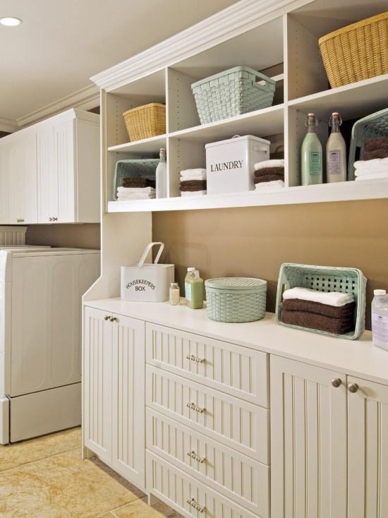 Laundry room design i like the narrow cabinet hall way for Open laundry room ideas