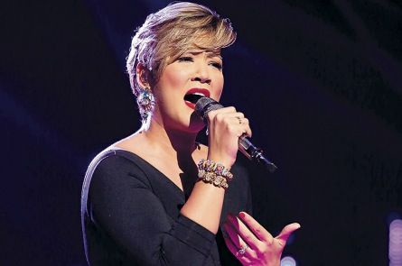 """Tessanne Chin sings during NBC's """"The Voice."""" She has progressed to ..."""