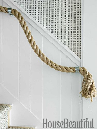For my next beach house :) Instead of a wood or iron hand rail , use a thick jute rope if you have a nautical style home. Thom Filicia Lake House - Rustic Lake House Decor - House Beautiful.  I would use rollocks as brackets.
