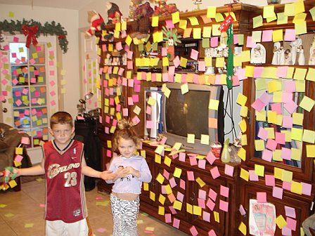 elf stuck post its all over the living room