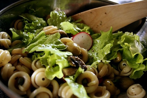 ... , radishes, olives, capers, and mushrooms in a vinaigrette dressing