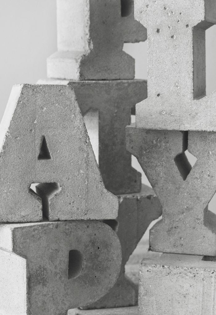 Hand-made letters, cast in concrete using unique wooden formworks ...