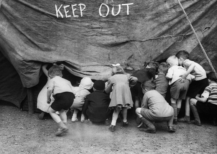 Small Children Sneak Into Circus Tent    by Corbis-Bettmann