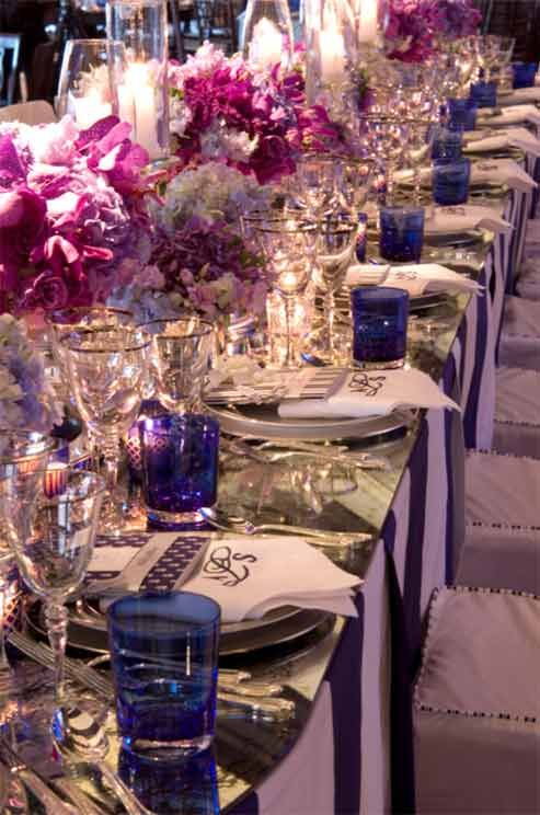 The head table featured navy blue and white striped linens and an antique mirrored top.