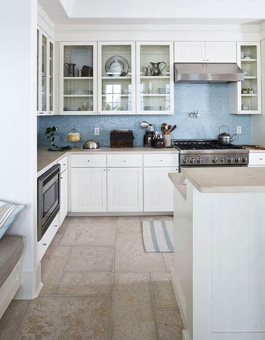 sandy counters, blue tile backsplash, off white sandy floor tiles