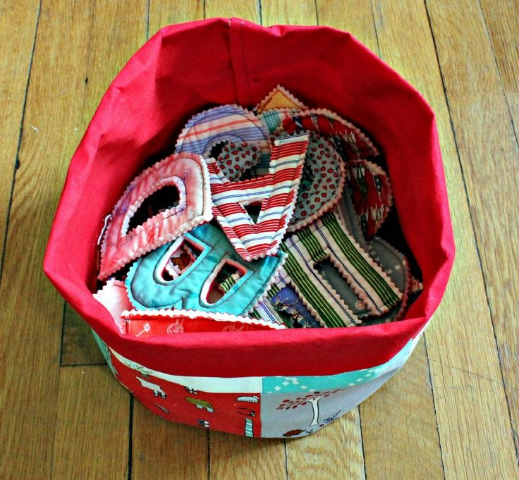 a bucket of letters made from scrap fabrics