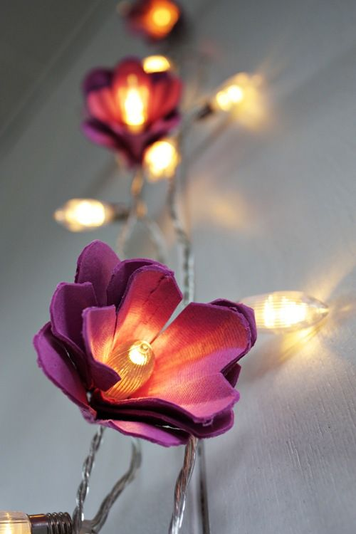 the coolest DIY egg carton trick ever: turn a string of Christmas lights into flower-shaped fairy lights.
