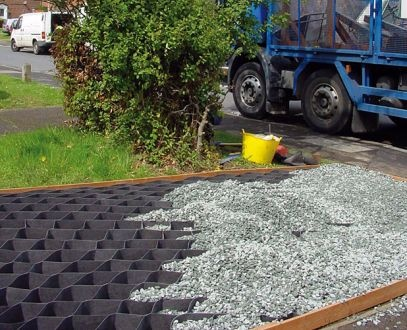 Geocells filled with a free draining crushed aggregate before a finish layer is installed.