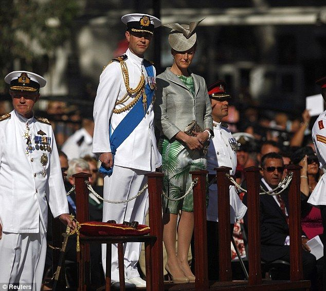 Pageantry: Prince Edward dressed in his naval uniform to watch the parade at Casemates square